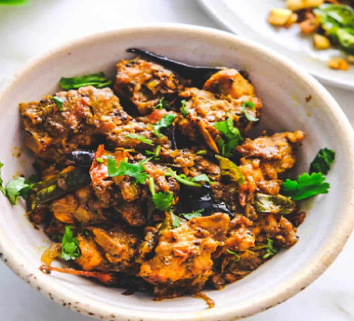 Chicken Pepper Fry is served in a plate in Aroma Indian Restaurant